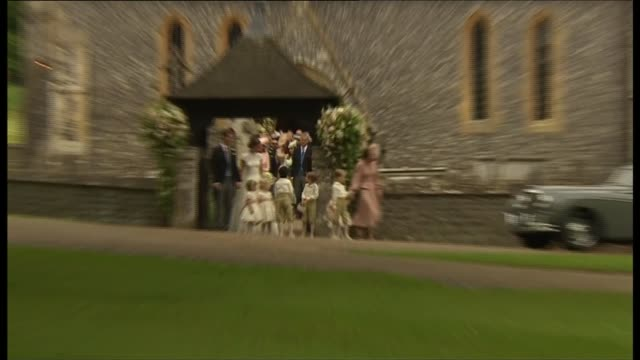 departures ENGLAND Berkshire Englefield St Mark's Church EXT Church departures Bride and groom Pippa Matthews and James Matthews from church kiss and...