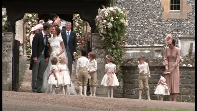 vídeos de stock, filmes e b-roll de departures second camera close shots of church departures bride and groom pippa matthews and james matthews from church kiss and to church gate... - bridesmaid