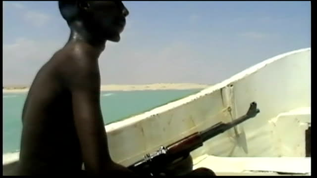 British ships to carry armed guards to prevent attack from pirates T25101022 Group of young Somali pirates on board small ship