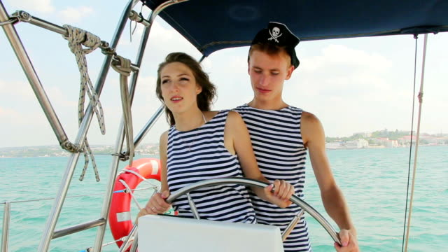 pirate crew at the helm of a yacht cruise - helm stock videos & royalty-free footage