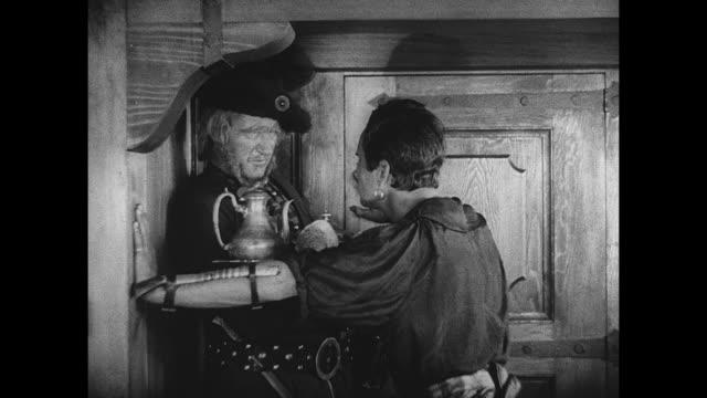 Pirate (Douglas Fairbanks) declares love for a woman hostage