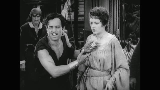 pirate (douglas fairbanks) devises a plan to help a captured woman - corruption stock videos and b-roll footage
