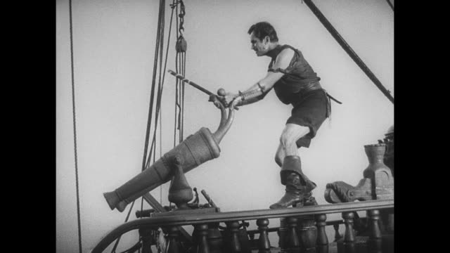 pirate (douglas fairbanks) gains controls over many crew members as he invades their ship - seeräuber stock-videos und b-roll-filmmaterial