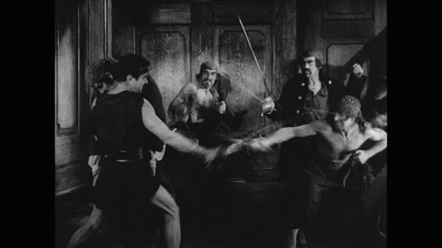 Pirate (Douglas Fairbanks) saves a woman hostage and kills her captor