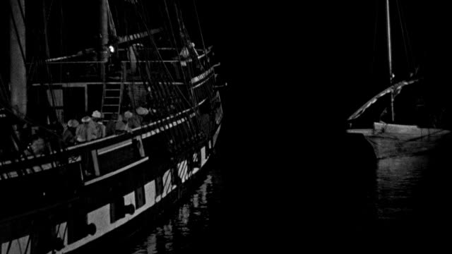 pirate sentries on the captured uss philadelphia watch as a u.s. marine boarding party pulls along side in a long boast. - military ship stock videos & royalty-free footage