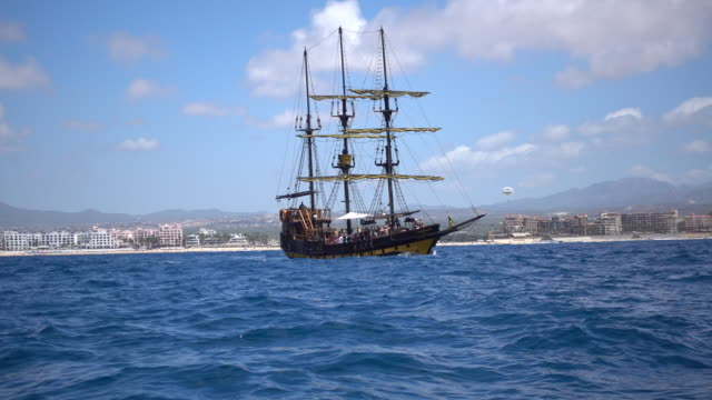 a pirate ship sails in cabo san lucas, mexico. - cabo san lucas stock videos & royalty-free footage
