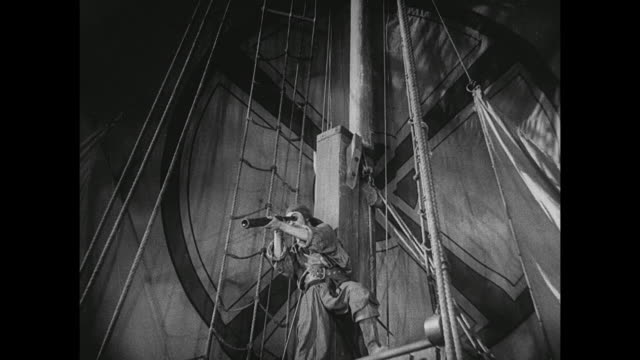 a pirate views something through a telescope and alerts his fellow men - schiffsmast stock-videos und b-roll-filmmaterial