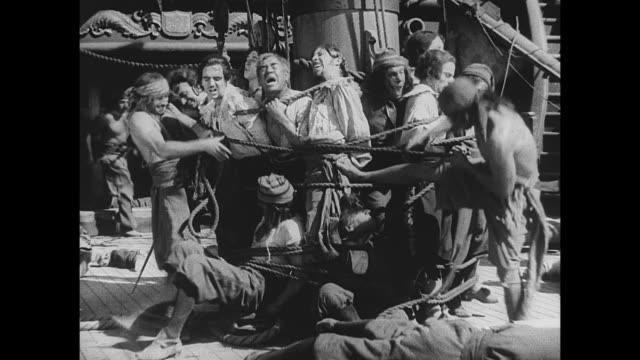 pirates torture a group that is held captive on a boat - silent film stock videos & royalty-free footage