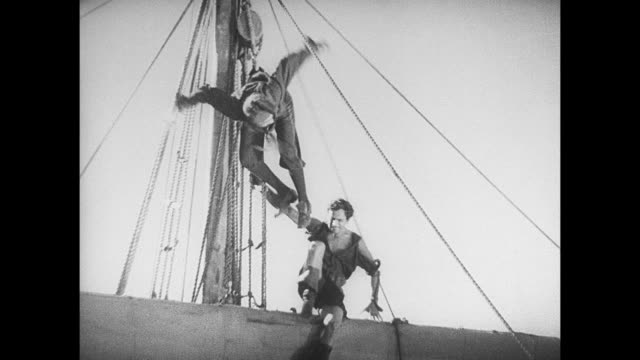 A pirate's victim is tied to the top of a mast
