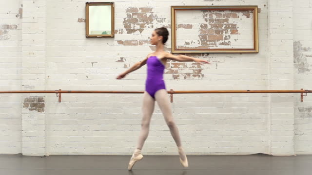 pirouettes from right to left - gymnastikanzug stock-videos und b-roll-filmmaterial