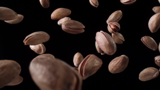 pistachios in the air - pistachio nut stock videos & royalty-free footage