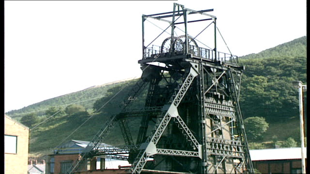 40 pit head pit wheel turning miners walking down aberfan steps 'merthyr vale colliery' sign lift shaft merthry gvs site graveyard seen in the... - valley stock videos & royalty-free footage