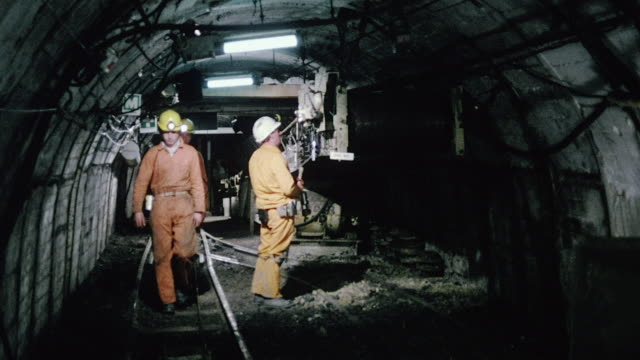 vidéos et rushes de montage pit safety officer checking in with supervisor below ground by telephone and inspecting firefighting equipment / kinsley, england, united kingdom - mineur de charbon