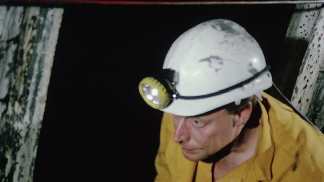montage pit safety officer inspecting mining equipment including roof support beams below ground / kinsley, england, united kingdom - miner stock videos & royalty-free footage