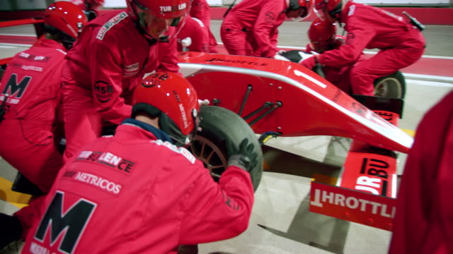 pit stop crew changing tyres on the formula - sports helmet stock videos & royalty-free footage