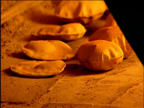 pita bread rises in oven as paddle lifts them out damascus - proofing baking technique stock videos and b-roll footage