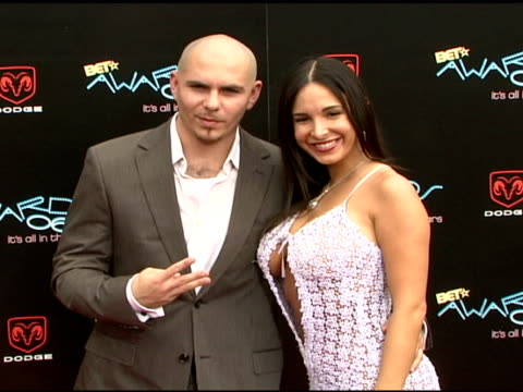 Pitbull and guest at the 2006 BET Awards arrivals at the Shrine Auditorium in Los Angeles California on June 27 2006