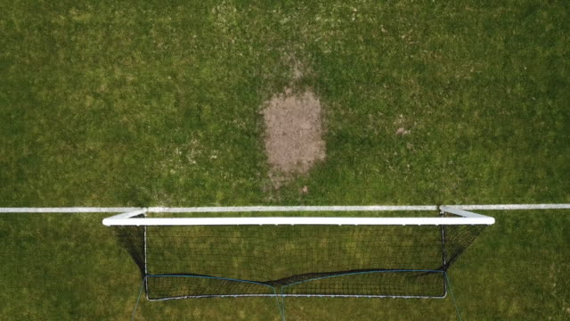 pitch, aerial view, football, goal area - football pitch stock videos and b-roll footage