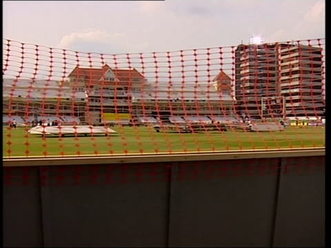 pitch invasion prevention measures / match fixing allegations; england: nottingham: trent bridge: ext plastic orange security netting pull focus... - median nerve stock videos & royalty-free footage
