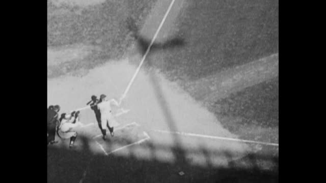 cu pitcher phil douglas of ny giants at game 1 of the world series / new york yankees pitcher carl mays warms up / tiltdown shot babe ruth gets a hit... - new york yankees stock-videos und b-roll-filmmaterial