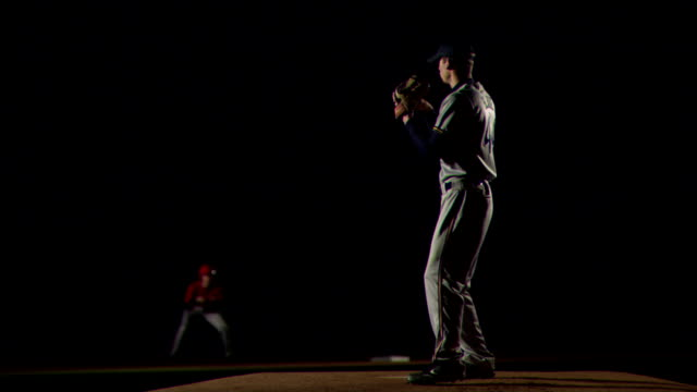 a pitcher throws a pitch. - baseball pitcher stock-videos und b-roll-filmmaterial