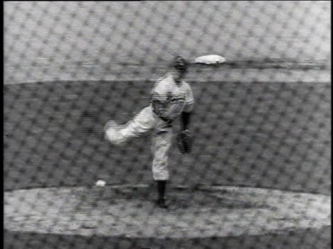 pitcher winding up and delivering / batter smacking the ball running rounding first base - ebbets field video stock e b–roll
