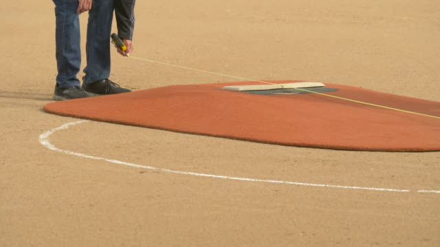 pitchers mound at a boys little league baseball game. - slow motion - tape measure stock videos & royalty-free footage