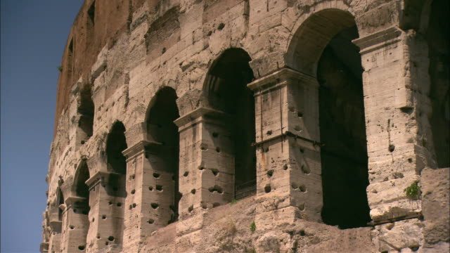 pits mar the exterior of the colosseum in rome, italy. - mar stock videos & royalty-free footage