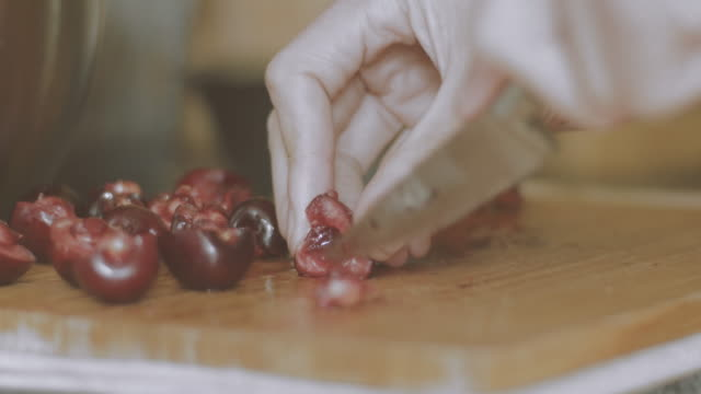 pitting fresh cherries by knife
