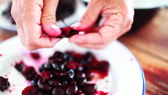Pitting Red Cherries
