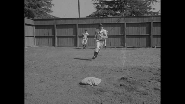 stockvideo's en b-roll-footage met pittsburgh pirates players george strickland and monty basgall throw ball at device designed by general manager branch rickey, which sharpens their... - bing crosby