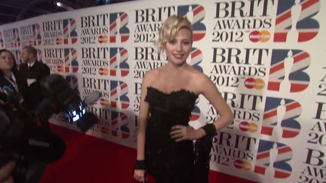 vidéos et rushes de pixie lott at the brit awards 2012 red carpet at the o2 arena, london, uk on february 21, 2012 - pixie lott