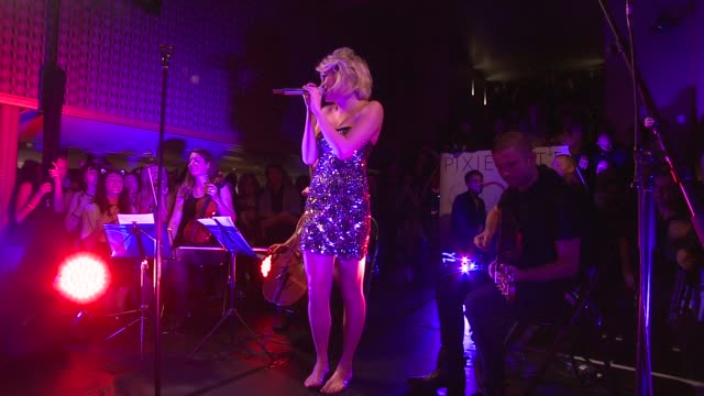 vidéos et rushes de pixie lott, performance at pixie lott album launch party 'young foolish happy' at london england. - pixie lott