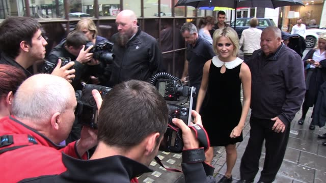 "pixie lott visits bbc radio one to promote her new single ""all about tonight"" and signs for fans in the rain outside. sighted: pixie lott at bbc... - bbc radio stock videos & royalty-free footage"