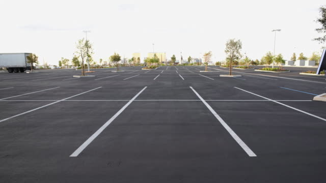 cgi ws pixilated arrows appearing on empty parking lot - parking stock videos & royalty-free footage