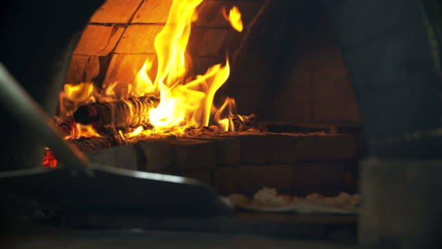 4K: Pizza baking in brick pizza oven