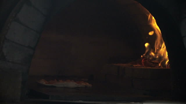 HD: Pizza baking in brick pizza oven