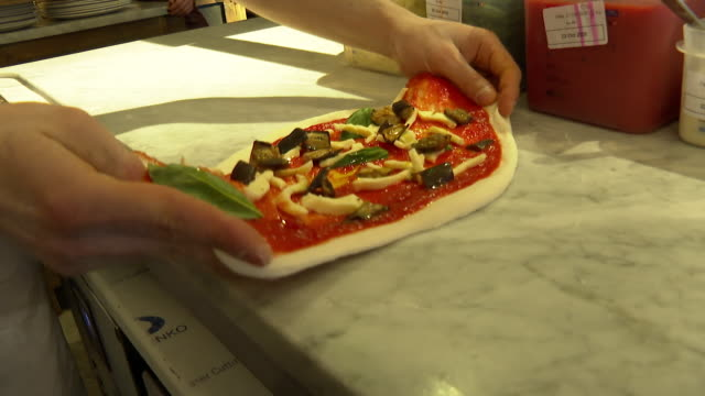 pizza being made in franco manca pizza restaurant - preparing food stock videos & royalty-free footage