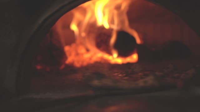 pizza being prepared in a pizza oven - pizza oven stock videos and b-roll footage