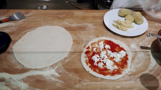 pizza chef preparing a pizza at the restaurant - proofing baking technique stock videos and b-roll footage