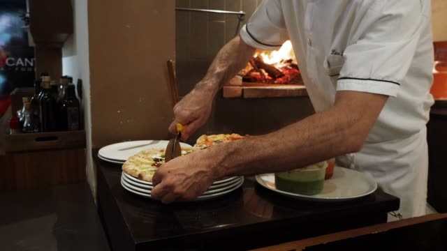 pizza chef preparing pizza at the restaurant - italian culture stock videos & royalty-free footage