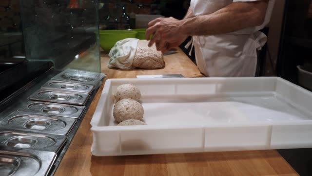 pizza chef preparing the pizza dough at the restaurant - proofing baking technique stock videos and b-roll footage