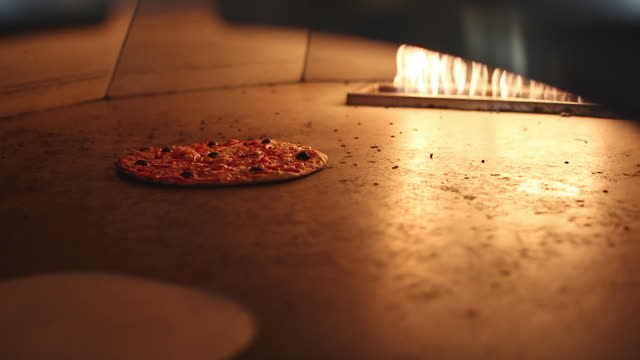pizza cooking in a pizza oven - pizza oven stock videos and b-roll footage