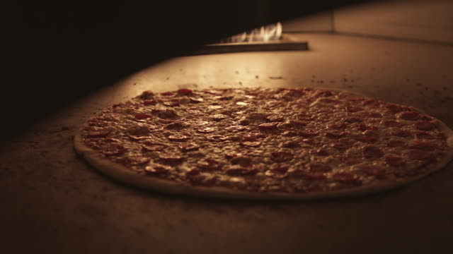 pizza cooking in a wood stone oven - pizza oven stock videos and b-roll footage