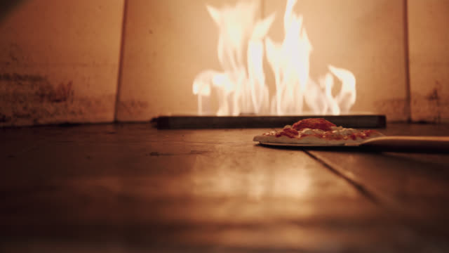 pizza in a brick oven - pizza oven stock videos and b-roll footage