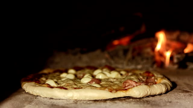 hd: pizza in the oven - hearth oven stock videos & royalty-free footage