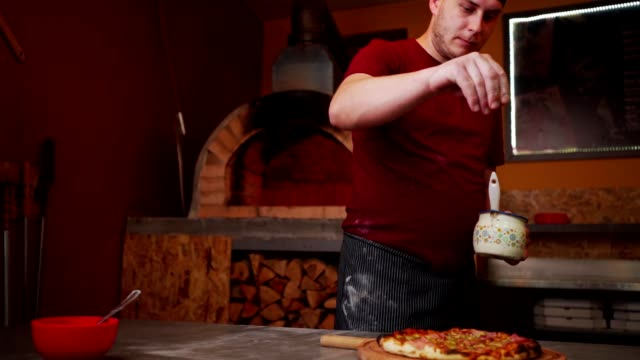 pizza master preparing pizza - sprinkling stock videos & royalty-free footage