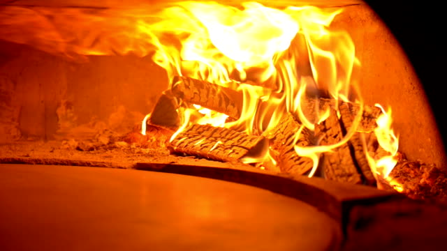 pizza oven with wood fire - pizza oven stock videos and b-roll footage