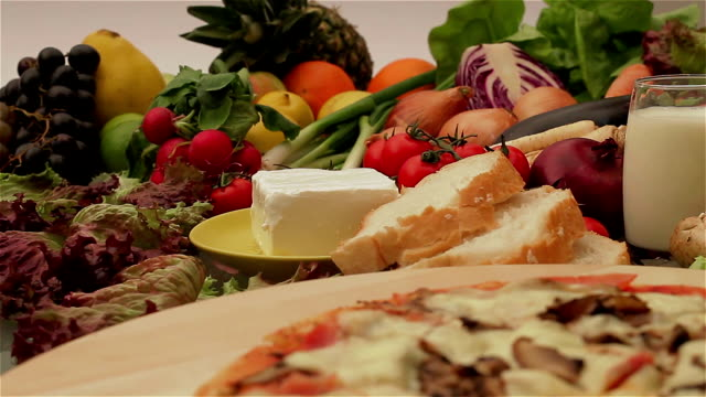 pizza with fresh vegetables and fruits - raw food diet stock videos & royalty-free footage
