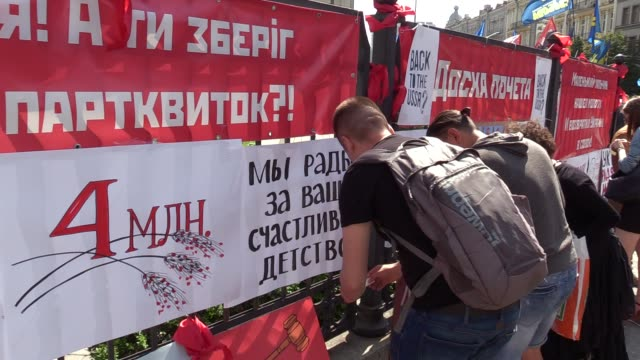 placards which parody soviet era propaganda installed by activists are seen on a fence the constitutional court, during a rally against possible... - satire stock-videos und b-roll-filmmaterial